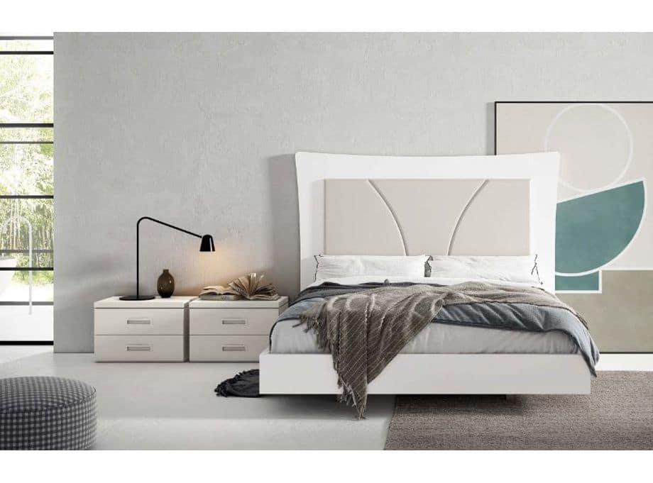 Dormitorio blanco con cabezal tapizado