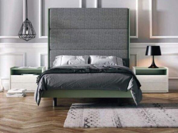 Dormitorio con cabezal tapizado y detalles en lago